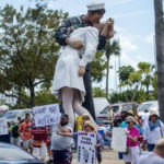 VIDEO: Protesters Demand Trump Tax Transparency as They March Across Ringling Bridge